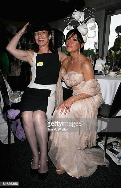 Kay Burley and Nancy Dell'Olio poses in the Mo*Vida Trackside VIP Room in the Royal Enclosure at Royal Ascot on June 21 2008 in London England