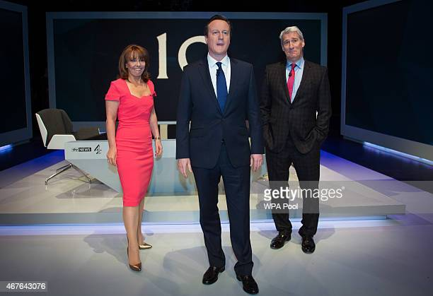 Kay Burley of Sky News British Prime Minister David Cameron and Jeremy Paxman of Channel 4 pose ahead of the filming of 'Cameron Miliband The Battle...