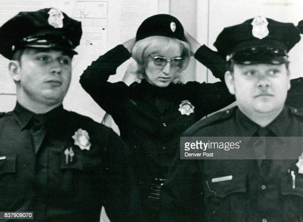 Kay Davidson arranges her hair during Station 2 roll call before leaving on patrol Fellow officers are Jeff Carroll left and Ross Damrell Credit...