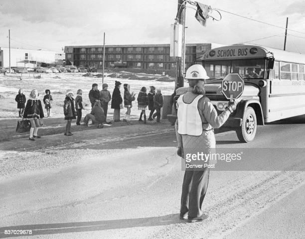 Kay Eflin Helps Direct Traffic at Busy School Crossing Littleton Mothers Establish Volunteer BusCrossing Guard Credit Denver Post