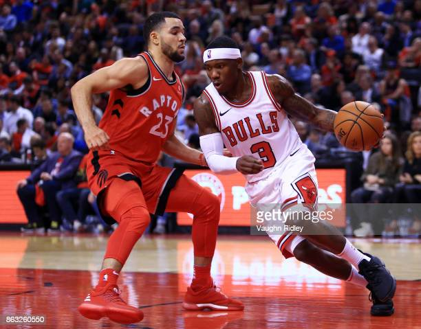 Kay Felder of the Chicago Bulls dribbles the ball as Fred VanVleet of the Toronto Raptors defends during the second half of an NBA game at Air Canada...