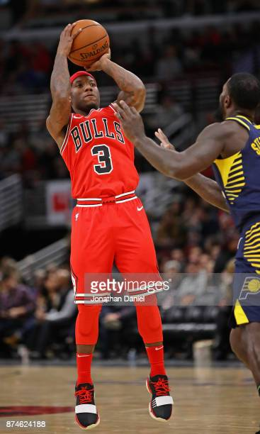 Kay Felder of the Chicago Bulls passes shoots over Lance Stephenson of the Indiana Pacers at the United Center on November 10 2017 in Chicago...