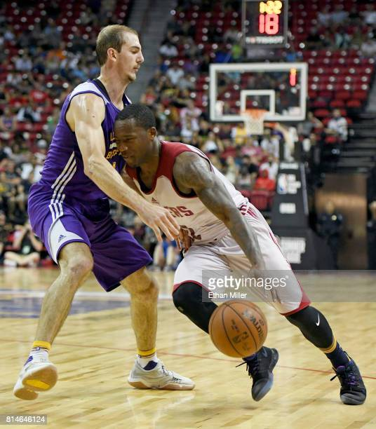Kay Felder of the Cleveland Cavaliers drives against Alex Caruso of the Los Angeles Lakers during the 2017 Summer League at the Thomas Mack Center on...