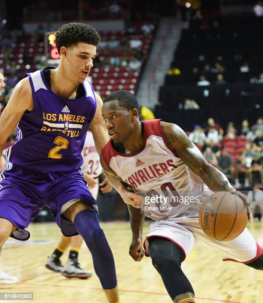Kay Felder of the Cleveland Cavaliers drives against Lonzo Ball of the Los Angeles Lakers during the 2017 Summer League at the Thomas Mack Center on...