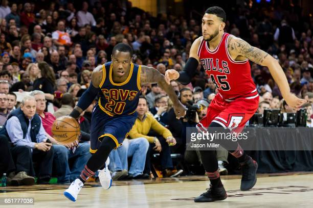 Kay Felder of the Cleveland Cavaliers drives around Denzel Valentine of the Chicago Bulls during the first half at Quicken Loans Arena on February 25...