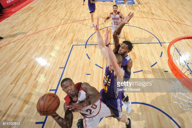 Kay Felder of the Cleveland Cavaliers goes to the basket against the Los Angeles Lakers on July 13 2017 at the Thomas Mack Center in Las Vegas Nevada...