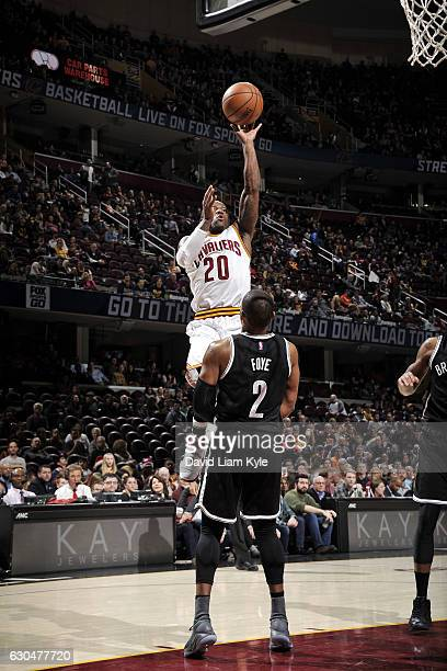 Kay Felder of the Cleveland Cavaliers shoots the ball during the game against the Brooklyn Nets on December 23 2016 at Quicken Loans Arena in...