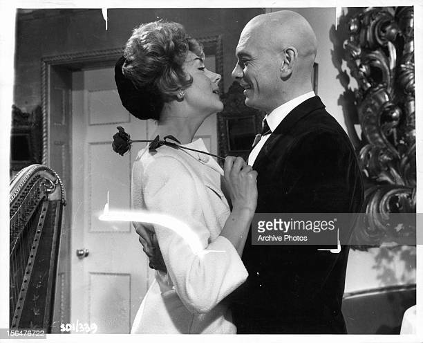 Kay Kendall is embraced by Yul Brynner in a scene from the film 'Once More With Feeling' 1960