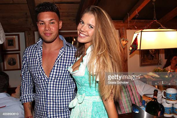 Kay One and Victoria Swarovski attend the 'Almauftrieb' at Kaefer tent during Oktoberfest at Theresienwiese on September 21 2014 in Munich Germany