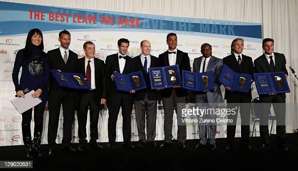 Kay Rush Ryan Giggs Antonio Caliendo Luis Figo Prince Albert II of Monaco Ruud Gullit Abedi Pele Rabah Madjer Javier Zanetti attend the Golden Foot...