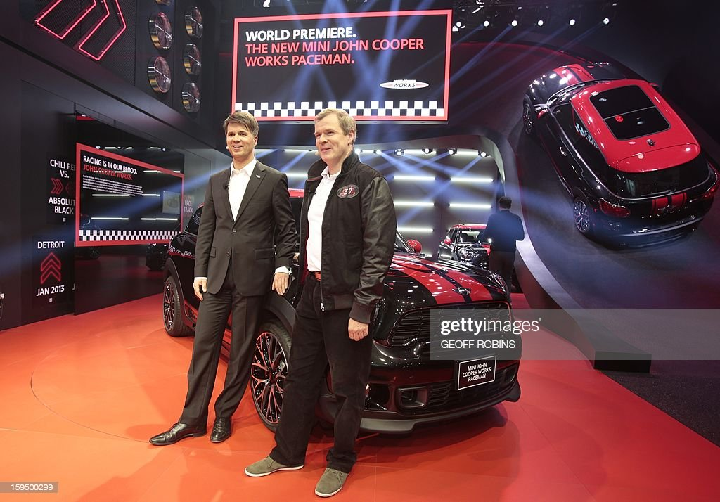 Kay Segler (R), Senior Vice President of the Nini Business Coordination and Brand Management, and Harald Krueger, member of the Board of Management of BMW, Mini, Motorcycles, Rolls Royce and Aftersales, introduce the Mini John Copper Works Paceman at the 2013 North American International Auto Show in Detroit, Michigan, on January 14, 2013. AFP PHOTO/Geoff Robins