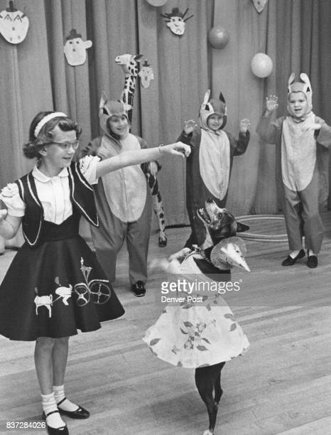 Kay Spurlock of 720 Elm St and her dog Skip perform for the crowd as two chipmunks fry to mimic the dog In costume are Skelley Steele of 830 Grape St...