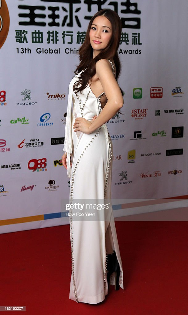 Kay Tse of Hong Kong poses during the red carpet prior to the start of the 13th Global Chinese Music Awards at Putra Stadium on October 5, 2013 in Kuala Lumpur, Malaysia.