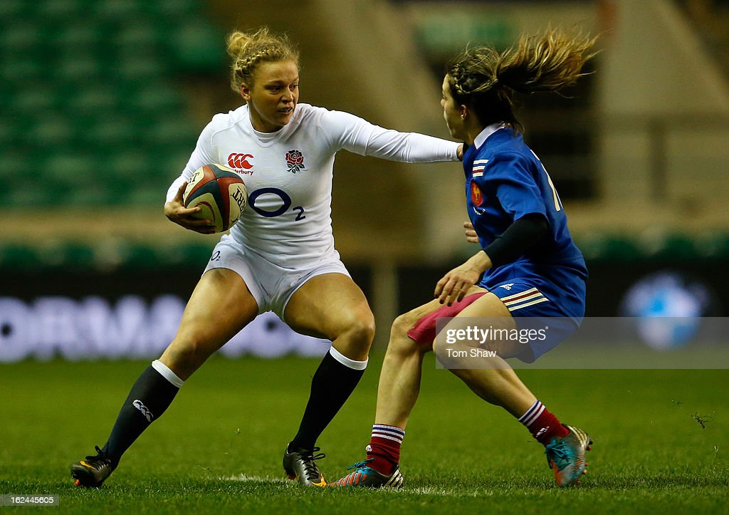 Kay Wilson of England hold off Elodie Guiglion of France during the Women's RBS Six Nations match between England and France at Twickenham Stadium on February 23, 2013 in London, England.