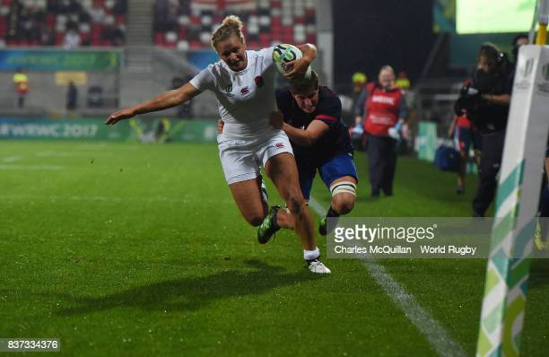 Kay Wilson of England is denied a try by Audrey Forlani of France during the Womens Rugby World Cup semifinal between England and France at the...