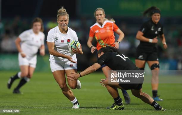 Kay Wilson of England moves past Portia Woodman during the Women's Rugby World Cup 2017 Final betwen England and New Zealand at the Kingspan Stadium...
