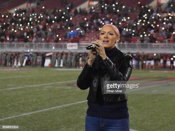 Kaya Jones sings 'God Bless America' before a game between the San Diego State Aztecs and the UNLV Rebels at Sam Boyd Stadium on October 7 2017 in...