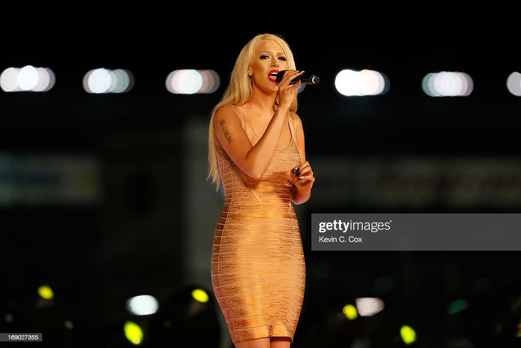 Kaya Jones sings the natinoal anthem during pre-race ceremonies for the NASCAR Sprint Cup Series All-Star race at Charlotte Motor Speedway on May 18, 2013 in Concord, North Carolina.