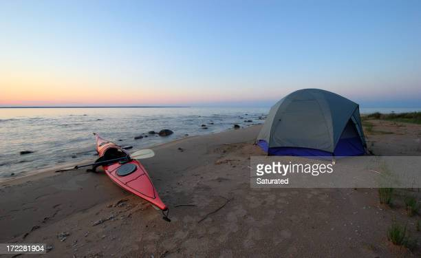 Kayak and Tent on Secluded Beach at Sunset