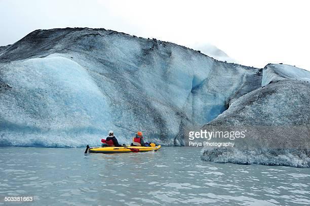 Kayak in icebergs