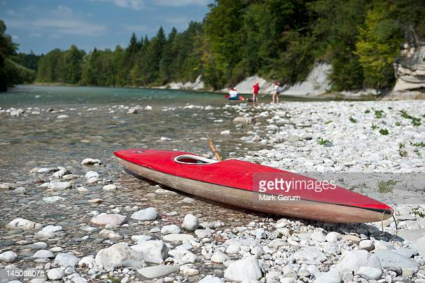 A kayak on a rocky beach