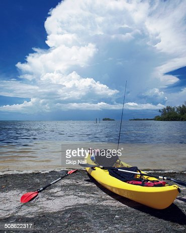 Kayak on the shore as storm approaches.
