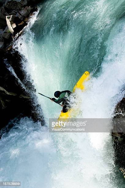 Kayaker dropping the waterfall.