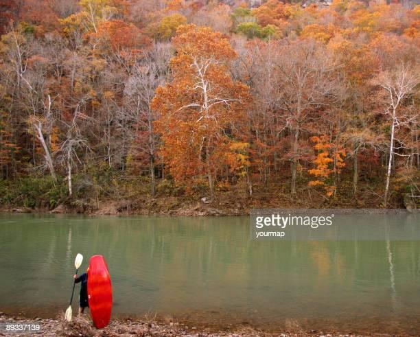 Kayaker enjoys Ozarks Autumn.