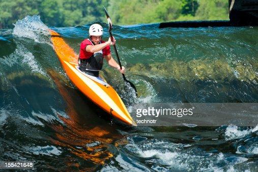 Kayaker entering to whitewater