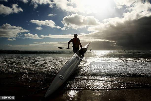 A kayaker heads out to sea during the Anaconda Adventure Race at Lorne Foreshore on December 7 2008 in Lorne Australia