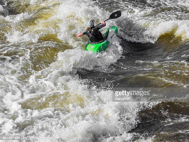 Kayaker on Bend Whitewater Park Deschutes River Bend Oregon