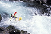 Kayaker Riding Rough Rapids
