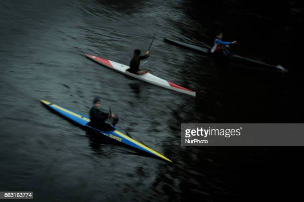 Kayakers are seen on the Brda river on 19 October 2017