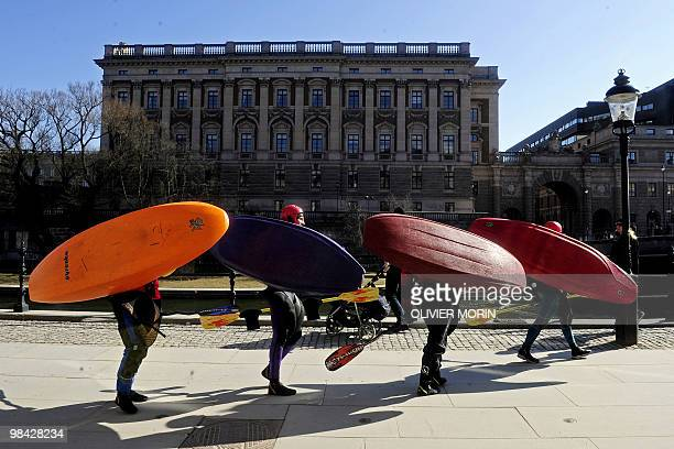 Kayakers look for a spot to enter the river near the Royal Palace in downtown Stockholm on April 11 2010 AFP PHOTO OLIVIER MORIN