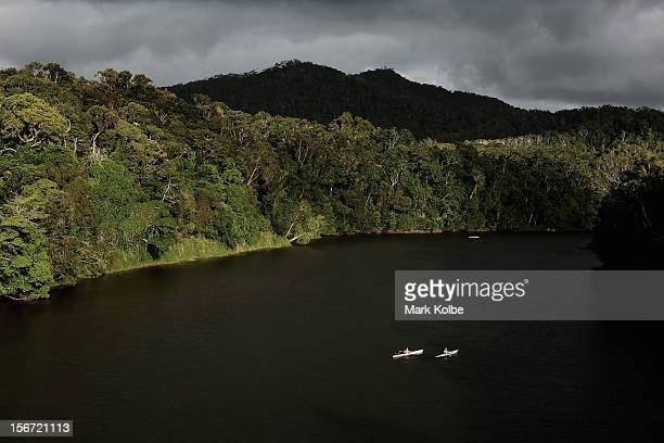 Kayakers paddle in the Barron River on November 14 2012 in Kuranda Australia Located in Far North Queensland the Cairns region is one of Australia's...