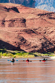 """Kayakers enjoy the view on a calm section at mile 66 on the Colorado river.  This is one of several images captured during a 200 mile, 16 day trip through the Grand Canyon."""