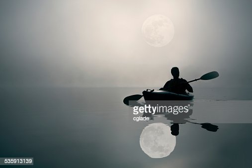 Kayaking and The Super Moon : Stock Photo