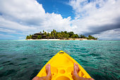 Kayaking by a tropical island in Fiji