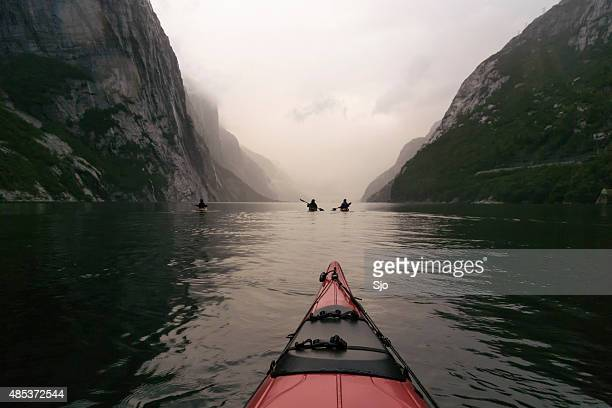 Kayaking in a Fjord in Norway during twilight