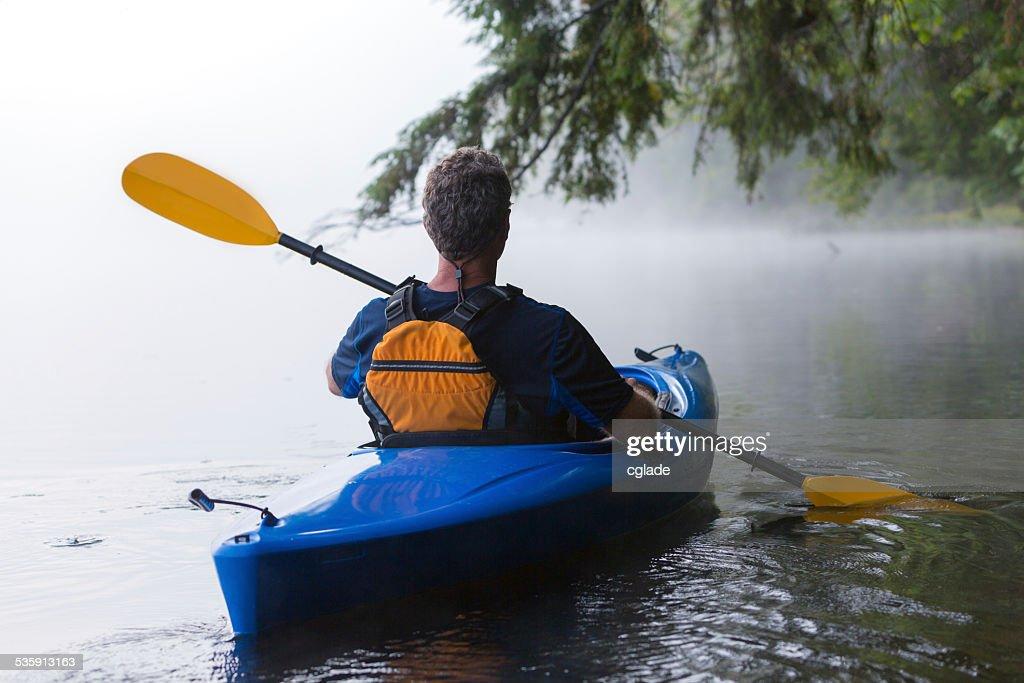 Kayaking near the shoreline : Stock Photo