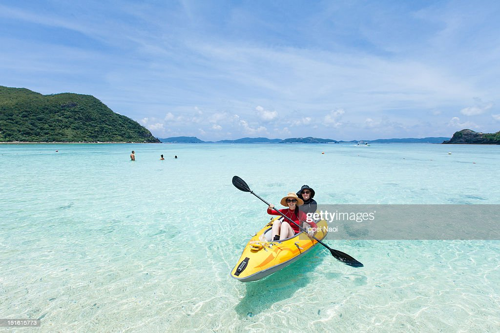 Kayaking on clear tropical water of a coral lagoon : Stock Photo
