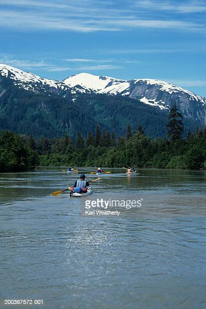 Kayaking on Stikine River, Alaska, USA, rear view