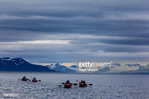 Kayaking under the midnight sun : Stock Photo
