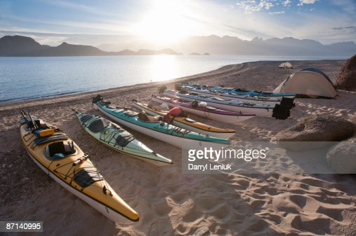 kayaks and tent on beach