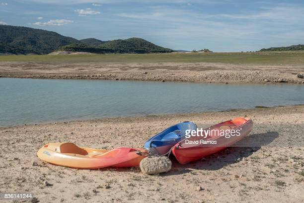 Kayaks are moored at Entrepenas reservoir second largest water reservoir feeding the Segura River and Spain's Southeastern regions which is at 12%...