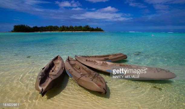Kayaks are tied up at Muri beach on the Island of Rarotonga the largest island in the Cook Islands is viewed from the air on August 30 2012 AFP PHOTO...