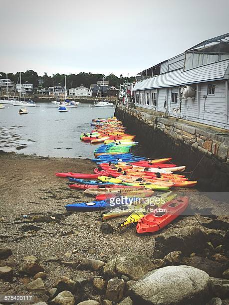 Kayaks Moored At Riverbank