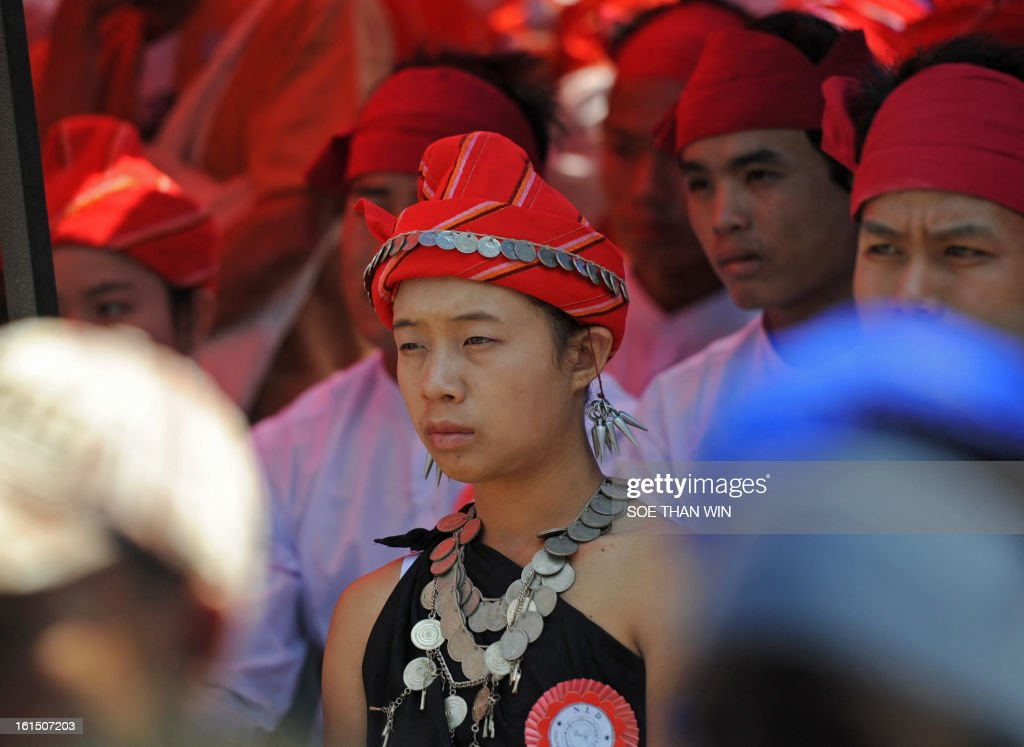 A Kayar ethnic woman attends a ceremony of the National League for Democracy (NLD) marking Myanmar's 66th Union Day anniversary in Yangon on February 12, 2013. Aung San Suu Kyi's National League for Democracy (NLD) said on February 11 it would hold its first ever national congress on March 8-10, reflecting the dramatic political changes sweeping Myanmar. AFP PHOTO/ Soe Than WIN