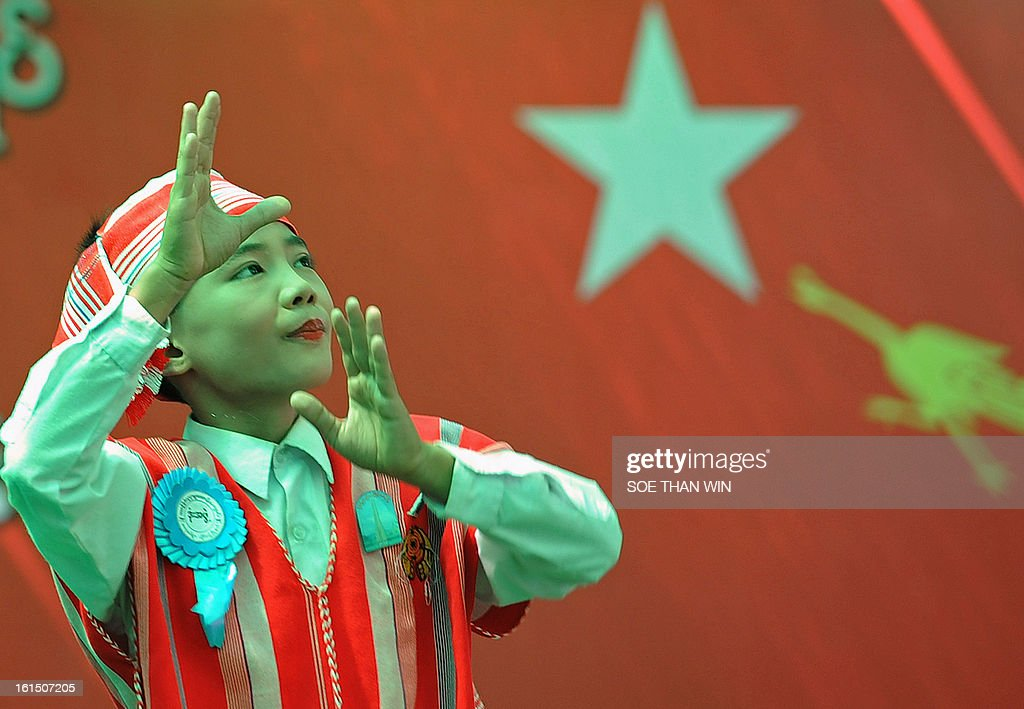 A Kayin ethnic boy performs a tradational dance during a ceremony of the National League for Democracy (NLD) marking Myanmar's 66th Union Day anniversary in Yangon on February 12, 2013. Aung San Suu Kyi's National League for Democracy (NLD) said on February 11 it would hold its first ever national congress on March 8-10, reflecting the dramatic political changes sweeping Myanmar. AFP PHOTO/ Soe Than WIN