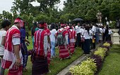 Kayin ethnic people come to pay their respect around a statue of General Aung San to mark Martyrs' Day in Yangon on July 19 2013 General Aung San and...